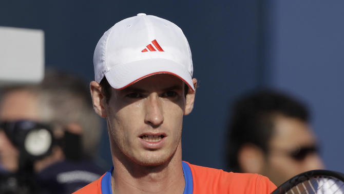 Andy Murray of  Britain reacts after defeating Michael Berrer of Germany during the Emirates Dubai ATP Tennis Championships in Dubai, United Arab Emirates, Tuesday, Feb. 28, 2012. (AP Photo/Hassan Ammar)