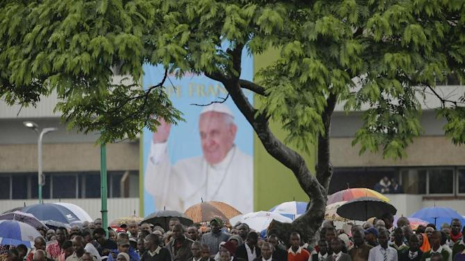 People wait for the arrival of Pope Francis to celebrate a mass on the campus of the University of Nairobi, Kenya, Thursday, Nov. 26, 2015. Pope Francis is in Africa for a six-day visit that is taking him to Kenya, Uganda and the Central African Republic. (AP Photo/Andrew Medichini)