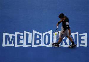 Novak Djokovic of Serbia walks during a break between points during his men's singles match against Lukas Lacko of Slovakia at the Australian Open 2014 tennis tournament in Melbourne