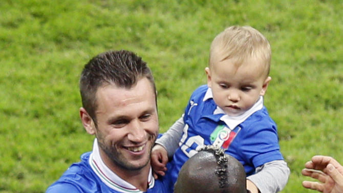 Italy's Antonio Cassano, left, holds his son Christopher as he celebrates with Mario Balotelli winning the Euro 2012 soccer championship semifinal match between Germany and Italy in Warsaw, Poland, Thursday, June 28, 2012. (AP Photo/Vadim Ghirda)
