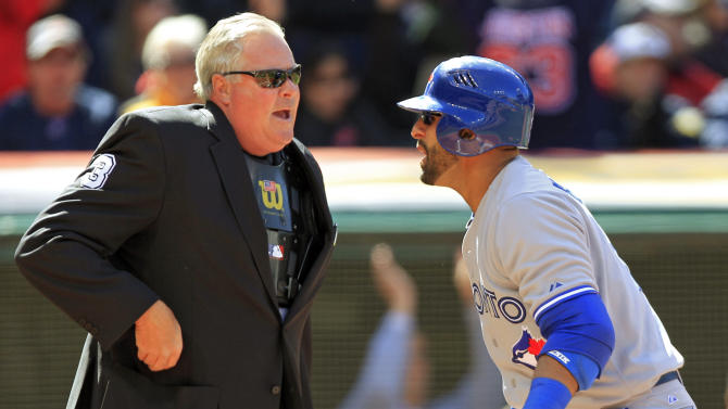 Toronto Blue Jays' Jose Bautista, right, argues with home plate umpire Tim Welke after being called out on strikes in the first inning of an opening day baseball game against the Cleveland Indians, Thursday, April 5, 2012, in Cleveland. (AP Photo/Mark Duncan)