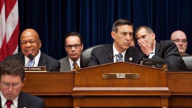 GOP Rep. Darrell Issa(center) confers with a congressional lawyer during the hearing on Benghazi, May 8.