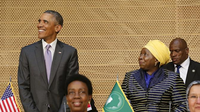 U.S. President Barack Obama smiles as he arrives with African Union Chairperson Nkosazana Dlamini-Zuma to deliver remarks at the African Union in Addis Ababa