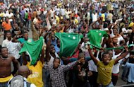 Fans celebrate Nigeria football team's victory over Ivory Coast to advance into semi final of the 2013 African Cup of Nations on February 3, 2013 in Lagos. Nigeria have asked FIFA to reschedule their World Cup qualifiers in June for fairness, arguing that all games in their group be played on the same day