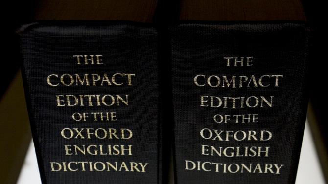 """FILE - In this Aug. 29, 2010 file photo, an Oxford English Dictionary is shown at the headquarters of The Associated Press in New York. A report that Oxford University had changed its comma rule left some punctuation obsessives alarmed, annoyed, and distraught. Passions subsided as the university said the news was imprecise, incomplete and misleading. Oxford University Press, birthplace of the Oxford comma, said Thursday, June 30, 2011, that there has been no change in its century-old style, and jumped into the Twittersphere to confirm that it still follows the standard set out in """"New Hart's Rules.""""  (AP Photo/Caleb Jones)"""