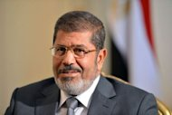 "Egypt's Supreme Constitutional Court said that all of its rulings were ""binding,"" in response to a presidential decree by Mohamed Morsi, seen here on July 8, reinstating parliament after the court ruled the house invalid"