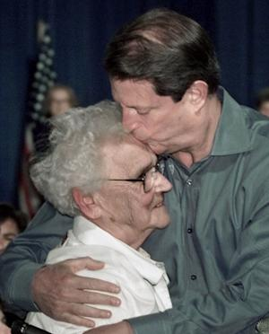FILE - In this Sept. 27, 2000, file photo Democratic presidential candidate Vice President Al Gore kisses Iowa retiree Winifred Skinner, 79, after listening to her talk about how she struggles with the high costs of prescriptions, as Gore spoke on his Medicare agenda at a community center in Altoona, Iowa. Wanna be famous? Forget reality TV. The presidential campaign could be just the ticket from nowhere to notoriety. It can be done with a heartfelt story. An off-hand remark. Or simply by having a distant connection to someone who's Somebody. Skinner told Gore she collects discarded cans to supplement her pension. (AP Photo/ J. Scott Applewhite, File)