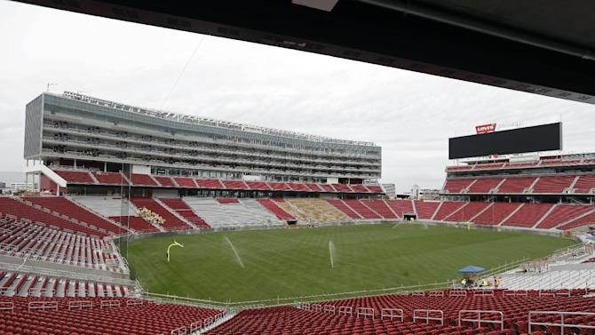 The newly-installed turf now covers the field at Levi's Stadium during a preview tour Monday, April 21, 2014, in Santa Clara, Calif. The installation of 2.5 acres of sod was completed over the weekend. The team selected West Coast Turf's Bandera Bermuda for the playing field. The new home of the San Francisco 49ers football team opens in August
