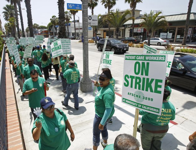 University of California patient care workers hold signs during a strike to demand for better contracts in Santa Monica