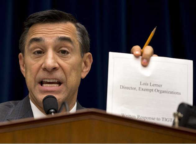 House Oversight Committee Chairman Rep. Darrell Issa, R-Calif. holds up a document as he speaks to IRS official Lois Lerner on Capitol Hill in Washington, Wednesday, May 22, 2013, during the committee