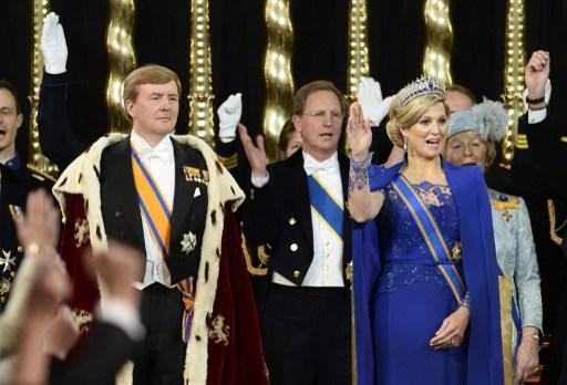 King Willem-Alexander of the Netherlands (L) stands by his wife Queen Maxima during his inauguration at the Nieuwe Kerk (New Church) in Amsterdam on April 30, 2013. AFP PHOTO / POOL / LEX VAN LIESHOUT