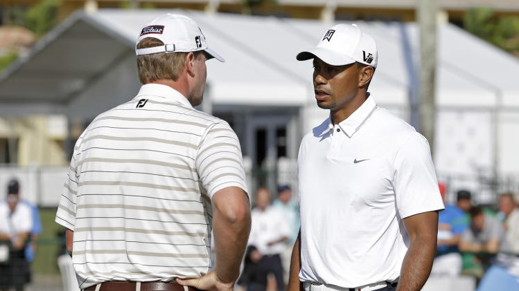 Tiger Woods, right, talks to Steve Stricker on the putting green at the Cadillac Championship golf tournament, in Doral, Fla., Wednesday March 6, 2013. (AP Photo/Alan Diaz)