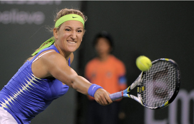 Victoria Azarenka, of Belarus, returns a shot to Angelique Kerber, of Germany, during their match at the BNP Paribas Open tennis tournament, Friday, March 16, 2012, in Indian Wells, Calif. (AP Photo/M
