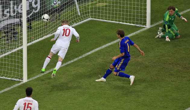 England's Wayne Rooney scores the opening goal during the Euro 2012 soccer championship Group D match between England and Ukraine in Donetsk, Ukraine, Tuesday, June 19, 2012. (AP Photo/Vadim Ghirda)