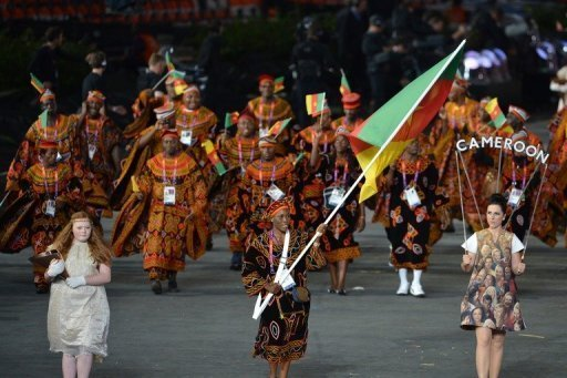 Cameroon's flagbearer Annabel Laure Ali (C) leads her delegation during the opening ceremony of the London 2012 Olympics