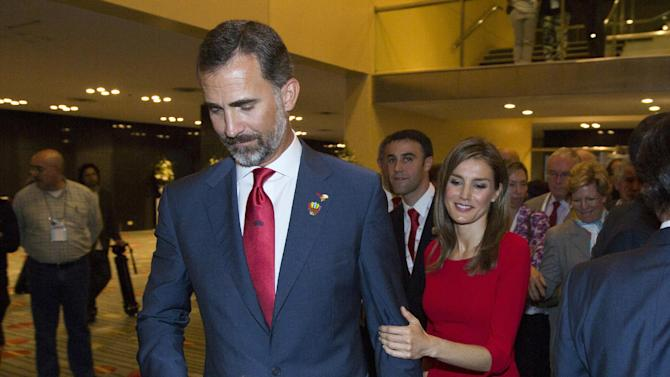 Spain's Crown Prince Felipe and and Princess Letizia leave after Madrid's 2020 final presentation in 125 IOC session in Buenos Aires, Argentina, Saturday, Sept. 7, 2013. Madrid has been eliminated as a host city for the 2020 Olympics, leaving Tokyo and Istanbul to advance to the final round. Madrid initially tied with Istanbul as an also-ran in the voting by the International Olympic Committee. Istanbul won the tiebreak vote 49-45. The winner will now be determined in a second-round vote between the Japanese and Turkish cities.(AP Photo/Ivan Fernandez)