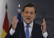 Spanish Prime Minister Mariano Rajoy, seen here on August 3, says Madrid will study the new financial aid measures planned by the European Central Bank to ease the eurozone debt crisis before deciding whether to use them