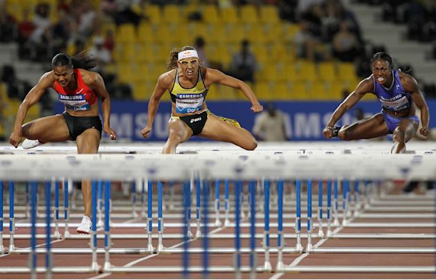 (L-R) Virginia Powell-Crawford, Lolo Jones and Danielle Carruthers of the US compete in the women's 100m hurdles at the IAAF Diamond League in Doha on May 6, 2011. AFP PHOTO/KARIM JAAFAR (Photo cr