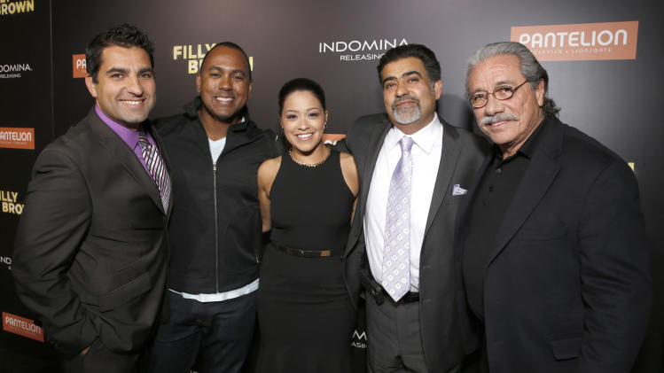 """Directors Youssef Delara and Michael Olmos, Gina Rodriguez, producer Amir Delara and Edward James Olmos attend Pantelion's """"Filly Brown"""" Los Angeles Premiere Hosted by the Rivera Family at the Regal LA Live Stadium on April 17, 2013 in Los Angeles. (Photo by Todd Williamson/Invision for Pantelion Films/AP Images)"""