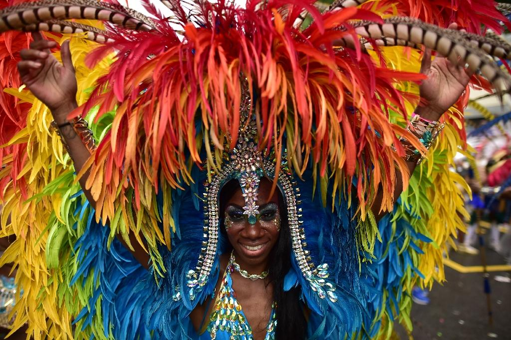 London's Notting Hill Carnival shimmies under downpour