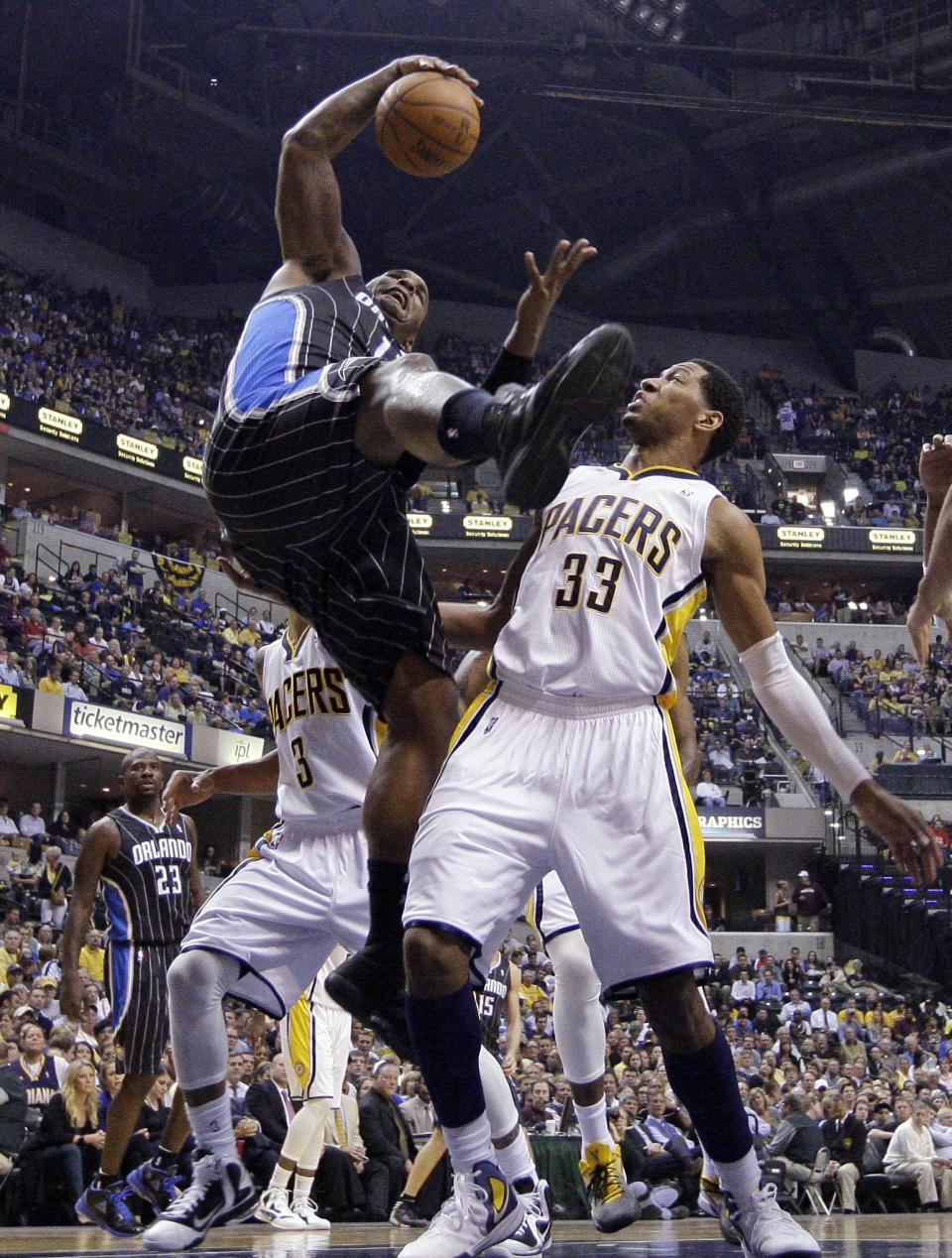 Orlando Magic forward Glen Davis, left, grabs a rebound in front of Indiana Pacers forward Danny Granger during the first half of the second game of an NBA first-round playoff basketball series, in Indianapolis on Monday, April 30, 2012. (AP Photo/Michael Conroy)