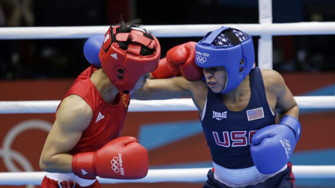 China's Ren Cancan, left, fights Marlen Esparza, of the United States during their women's semifinal flyweight 51-kg boxing match at the 2012 Summer Olympics, Wednesday, Aug. 8, 2012, in London. (AP Photo/Patrick Semansky)