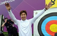South Korea's Im Dong-Hyun celebrates breaking his own 72-arrow world record in the archery ranking round with a score of 699 at the Lord's Cricket Ground in London on July 27. Legally-blind Im scored 699 points from 72 arrows to beat his own record of 696 set in May this year