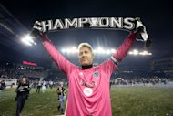 KANSAS CITY, KS - DECEMBER 7: Jimmy Nielsen #1 of Sporting Kansas City holds up a championship scarf as he celebrates winning the MLS Cup Final against Real Salt Lake at Sporting Park on December 7, 2013 in Kansas City, Kansas. (Photo by Ed Zurga/Getty Images)