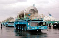 Canisters containing spent nuclear fuel are carried on trailers to the nuclear reprocessing plant at Rokkasho village in Aomori prefecture, 600km north of Tokyo, on December 19, 2000. Japan&#39;s only reprocessing plant for spent nuclear fuel could sit on an active seismic fault vulnerable to a massive earthquake, experts warned Wednesday