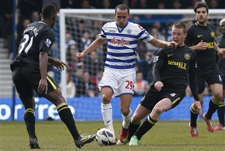 Wigan Athletic's Figueroa and McCarthy challenge Queens Park Rangers' Townsend during their English Premier League soccer match at Loftus Road in London