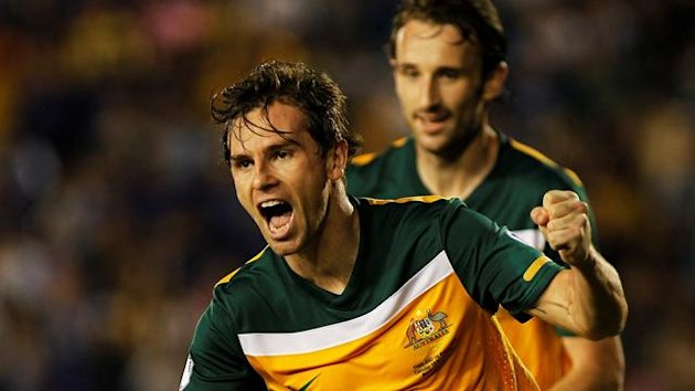 Australia's Brett Holman (L) celebrates scoring against Thailand during their 2014 World Cup qualifying soccer match in Bangkok November 15, 2011
