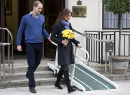 FILE- In this Thursday, Dec. 6, 2012 file photo, Britain&#39;s Prince William stand next to his wife Kate, Duchess of Cambridge as she leaves the King Edward VII hospital in central London. Prince William and his wife Kate are expecting their first child, and the Duchess of Cambridge was admitted to hospital suffering from a severe form of morning sickness in the early stages of her pregnancy. King Edward VII hospital says a nurse involved in a prank telephone call to elicit information about the Duchess of Cambridge has died. The hospital said Friday, Dec. 7, 2012 that Jacintha Saldanha had been a victim of the call made by two Australian radio disc jockeys. They did not immediately say what role she played in the call. (AP Photo/Alastair Grant, File)