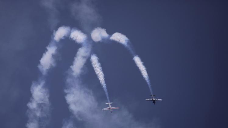 Abarth aircraft perform aerobatic display during preparations for the India Aviation show at Begumpet airport in Hyderabad, India, Monday, March 10, 2014. The five-day show will begin on March 12. (AP Photo/Mahesh Kumar A.)