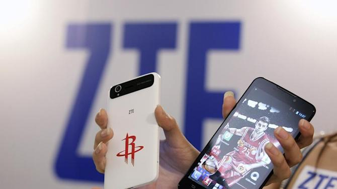 ZTE smartphones Grand Memo Lite and Grand S are displayed during a news conference in Taipei