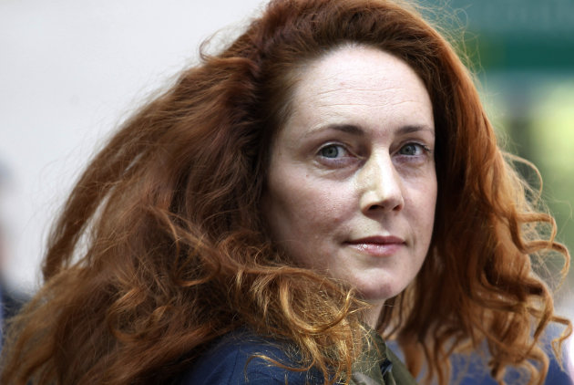 FILE This Wednesday, June 13, 2012 file photo shows Rebekah Brooks, former chief executive of News International, leaving Westminster Magistrates' Courts after she was granted bail on charges of attem