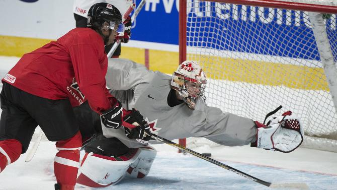 Team Canada goaltender Zach Fucale makes a save against teammate Anthony Duclair during practice session in preparation for the upcoming IIHF World Junior Championships in Montreal, Thursday, Dec. 25, 2014. (AP Photo/The Canadian Press, Graham Hughes)