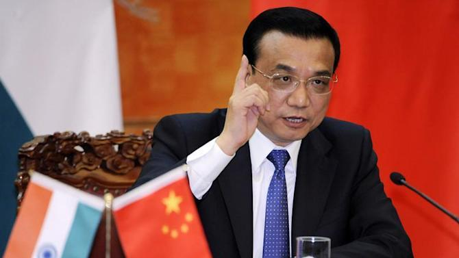 Li Keqiang speaks during a joint news conference with Manmohan Singh at the Great Hall of the People in Beijing