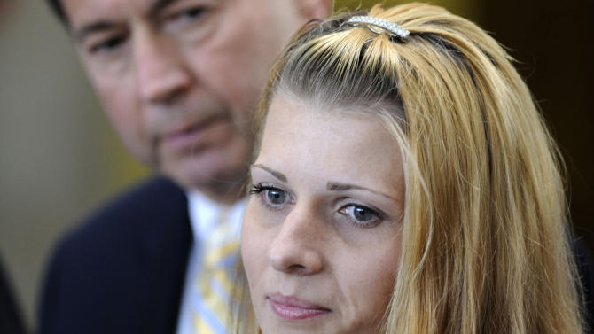 FILE - In this June 23, 2009 file photo Karolina Obrycka, right, with her attorney Terry Ekl, speaks outside the Cook County courthouse in Chicago, after Chicago police officer Anthony Abbate was sentenced to two years probation and anger management classes for the videotaped attack against her that went viral on the internet. On Tuesday, Nov. 13, 2012, jurors at a federal civil trial found that Chicago police adhered to a code of silence protecting fellow officers in the case brought by a Obrycka. The jurors awarded the Obrycka $850,000 in damages. (AP Photo/Paul Beaty, File)