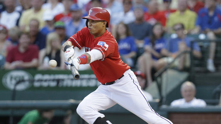 Texas Rangers' Leonys Martin bunts during the third inning of a baseball game against the Toronto Blue Jays, Thursday, June 13, 2013, in Arlington, Texas. (AP Photo/LM Otero)
