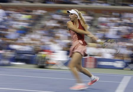 Caroline Wozniacki of Denmark comes to the net against Sara Errani of Italy during their women's quarter-finals singles match at the 2014 U.S. Open tennis tournament in New York