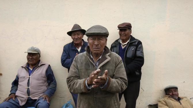 Pensioners rest during a march in Patacamaya