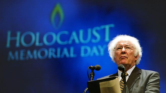 FILE - A Tuesday, Jan. 27, 2004 photo from files showing former Nobel Prize winning poet Seamus Heaney speaking during a rehearsal for the Northern Irish national Holocaust commemoration at the Waterfront Hall, Belfast, Northern Ireland. Seamus Heaney, Ireland's foremost poet who won the Nobel literature prize in 1995, has died after a half-century exploring the wild beauty of Ireland and the political torment within the nation's soul. He was 74. Heaney's family and publisher, Faber & Faber, say in a statement that Heaney died Friday in a Dublin hospital. (AP Photo/Peter Morrison, File)