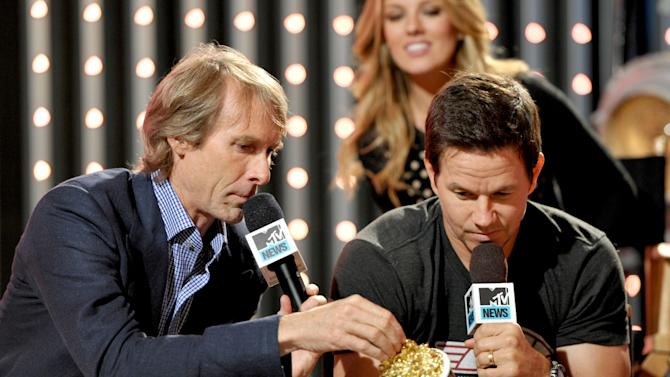 """Director of  """"Pain & Gain"""" Michael Bay is seen with actor Mark Wahlberg at """"The MTV Movie Awards Sneak Peek Week"""" on Tuesday, April 9, 2013 in Universal City, Calif. (Photo by John Shearer/Invision for MTV/AP Images)"""