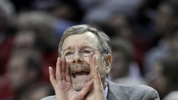 Brooklyn Nets coach P.J. Carlesimo calls out from the bench during the second half of an NBA basketball game against the Portland Trail Blazersin Portland, Ore., Wednesday, March 27, 2013.  Brooklyn won 111-93.(AP Photo/Don Ryan)