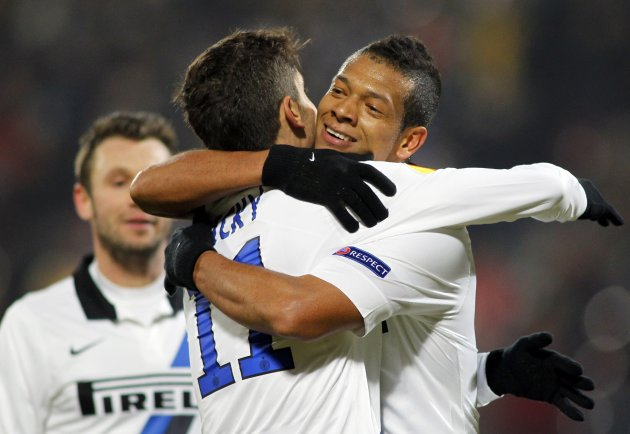 Inter Milan's Guarin celebrates with teammates Alvarez and Cassano after scoring against CFR Cluj during their Europa League soccer match in Cluj-Napoca