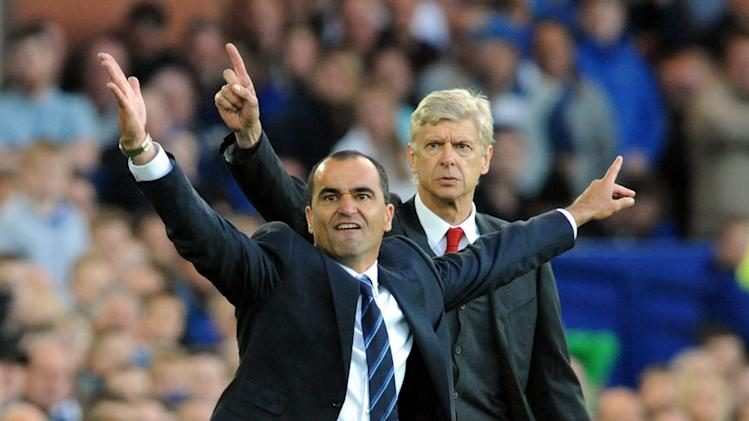Everton's manager Roberto Martínez, left, and Arsenal's manager Arsene Wenger react during the English Premier League soccer match between Everton and Arsenal at Goodison Park, in Liverpool, England, Saturday, Aug. 23, 2014. (AP Photo/Rui Vieira)