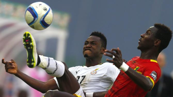 Baba Rahman of Ghana fights for the ball with Guinea's Mohamed Lamine Yattara during their quarter-final soccer match of the 2015 African Cup of Nations in Malabo