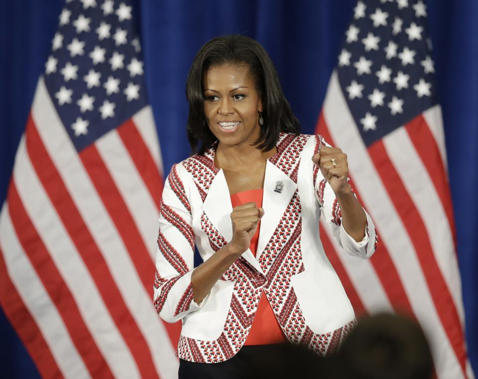 First lady Michelle Obama reacts before speaking during a breakfast with Team USA at the 2012 Summer Olympics, Friday, July 27, 2012, in London. (AP Photo/Darron Cummings)