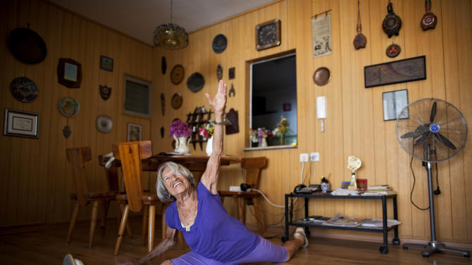 Agnes Keleti, a 91-year-old former Olympic gymnast, performs a split at her house in Herzliya, Israel, Monday, Aug. 13, 2012. Keleti won 10 Olympic medals, including 5 gold medals, while she represented Hungary in the Olympic games of 1948, 1952, and 1956. (AP Photo/Oded Balilty)