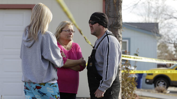 "Neighborhood residents talk amid crime-scene tape at the scene of an apparent murder-suicide, which officials say left four dead inside a home, according to officials, in Longmont, Colo., Tuesday Dec. 18, 2012.  Weld County sheriff's spokesman Tim Schwartz says dispatchers heard the woman who called 911 scream ""No, no, no,"" and then they heard a gunshot. Schwartz says a man grabbed the phone and said he was going to kill himself, and dispatchers heard another shot.  (AP Photo/Brennan Linsley)"